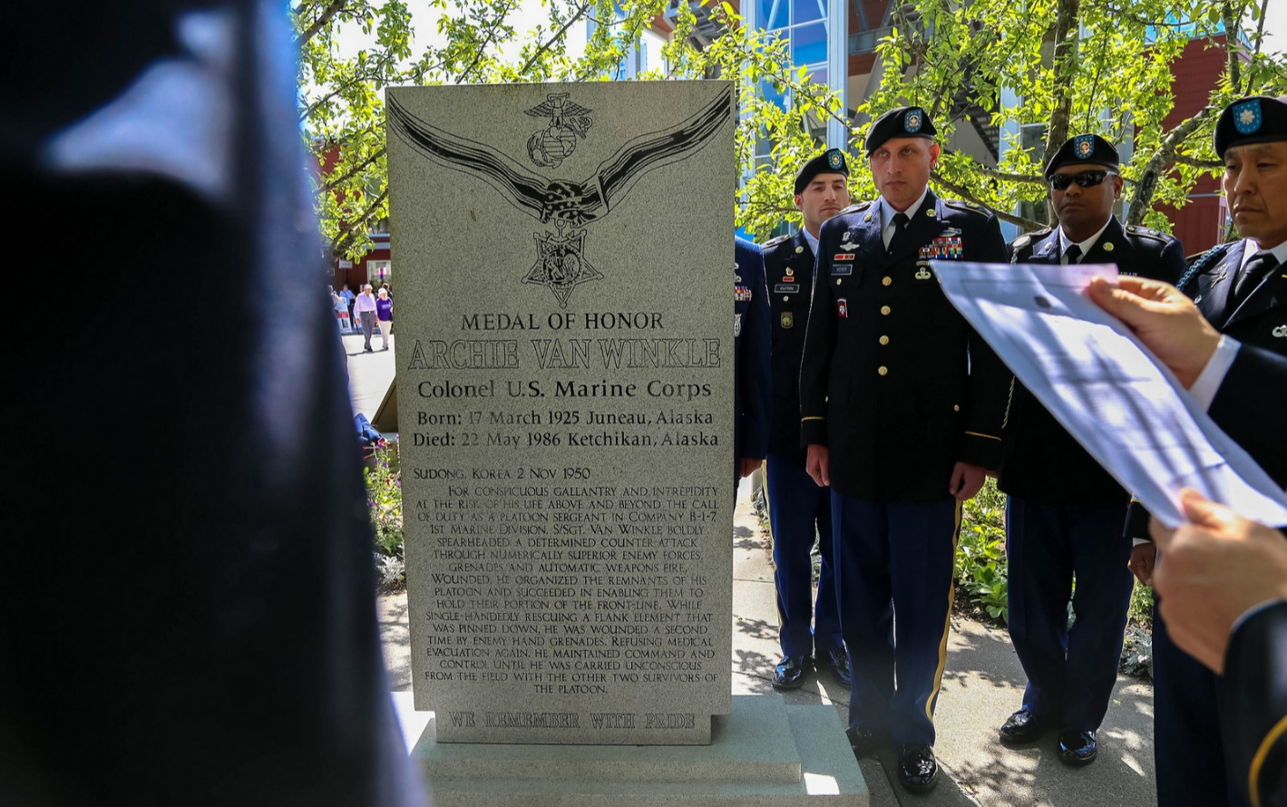 Members of the 103rd Civil Support Team pay homage to Medal of Honor recipient at his granite memorial in downtown Juneau. Image-National Guard