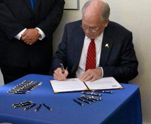 Alaska's Governor Walker signs SB 91 bill on Monday.Image-State of Alaska