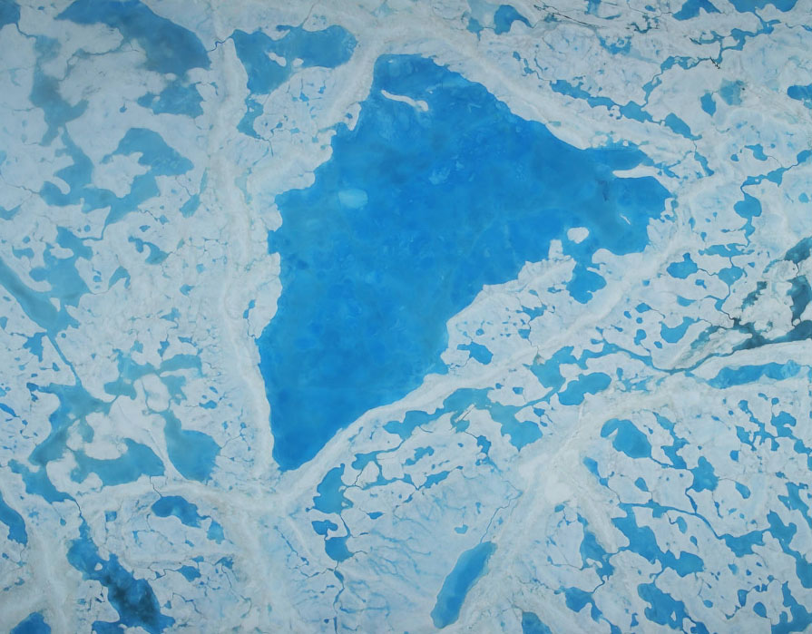 A large pool of melt water over sea ice, as seen from an Operation IceBridge flight over the Beaufort Sea on July 14, 2016. During this summer campaign, IceBridge will map the extent, frequency and depth of melt ponds like these to help scientists forecast the Arctic sea ice yearly minimum extent in September. Credits: NASA/Operation IceBridge