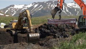 Two excavators dig up contaminated soil and old, rusted diesel drums June 20 at Attu Island, the western-most island in the Aleutian chain. (Photo by Dena O'Dell, USACE-Alaska District Public Affairs)