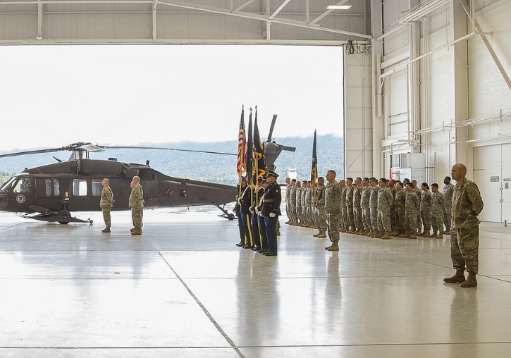 Alaska National Guardsmen observing Col. Jeffery Roach, 38th Troop Command commander, transfer command to Lt. Col. Wayne Don at a ceremony on Bryant Army Airfield on Joint Base Elmendorf-Richardson, August 7, 2016. (U.S. Army National Guard photo by Sgt. Julio Velez)