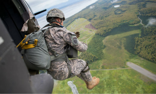 Alaska Army National Guard Soldiers with B Company, 1st Battalion (Airborne),143rd Infantry Regiment, jump out of a UH-60 Black Hawk for the unit's final jump before they retire their airborne status.(U.S. Air Force photo by Senior Airman James Richardson)
