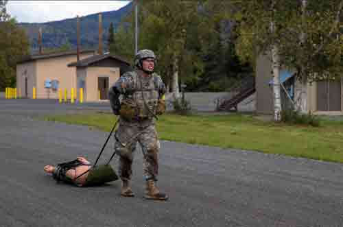 Spc. Trent Marnell, a military policeman with the 49th Missile Defense Battalion, Alaska Army National Guard, participates in the casualty evacuation event during the Best Warrior Competition.(Army National Guard photo by Officer Candidate Marisa Lindsay)