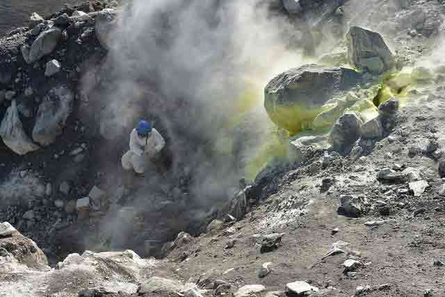 DECADE's Taryn Lopez (University of Alaska Fairbanks, USA) collects gas samples at Kanaga volcano in the Western Aleutian Islands. Credit: Tobias Fischer, University of New Mexico, USA.