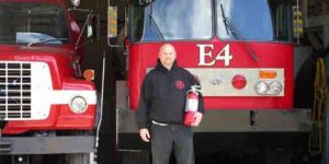 Gakona Volunteer Fire Department Chief Jason Severs accepted the fire extinguishers donated by HAARP. Photo by Marty Karjala.
