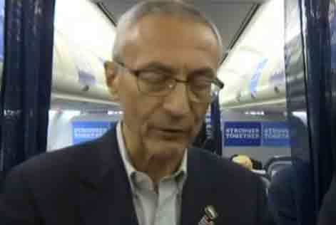 Clinton Campaign chief, John Podesta speaking to reporters on the campaign plane about latest round of email releases. Image-Screengrab