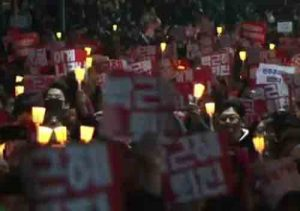 THrongs of protesters fill the streets calling for South Korea's president step down from office. Image-screengrab