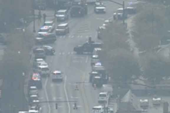 Police vehicles line the street following the knife attack at OSU.