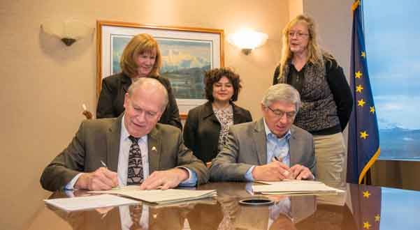 Governor Bill Walker and Lt. Governor Byron Mallott signing election certification documents. with Division of Elections staff (L-R) Julie Husmann, Indra Arriaga, and Carol Thompson watching on. Image-State of Alaska