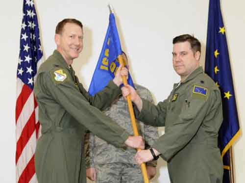 Lt. Col. Benjamin Doyle assumed command of the 168th Operations Support Squadron, Alaska Air National Guard, December 22, 2016 during a ceremony held at the unit's operations group theater Eielson AFB. (U.S. Air National Guard photo by Senior Master Sgt. Paul Mann/Released)
