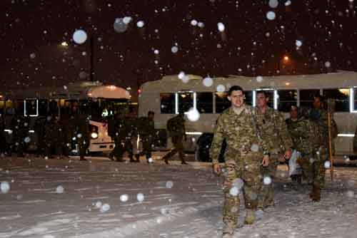 Anchorage's first decent snowfall of the winter welcomed the 109th Transportation Company's Dec. 1 return from a nine-month deployment to Kuwait. Photo by John Pennell United States Army Alaska