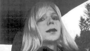 Pfc. Chelsea Manning poses for a photo wearing a wig and lipstick. Image-US Army