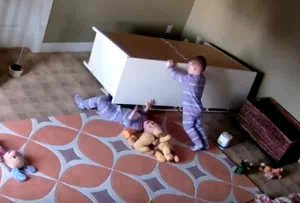 2-year-old Bowdy Shoff works to free his twin brother from under fallen dresser. Image-Kayli Shoff