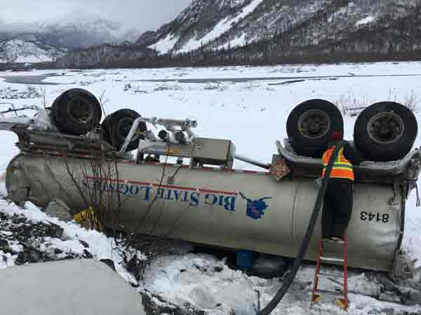 Response crew off-loading diesel fuel from overturned tanker on the Richardson Highway. Image-DEC