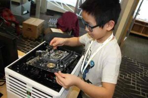 Anson Jimmy, of Bethel, finishing up a computer built as part of ANSEP's hands-on STEM learning activities. Image-ANSEP