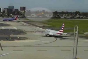 Airport cameras captured Harrison Ford's aircraft overflying an American Airlines passenger jet at Orange County's John Wayne Airport.