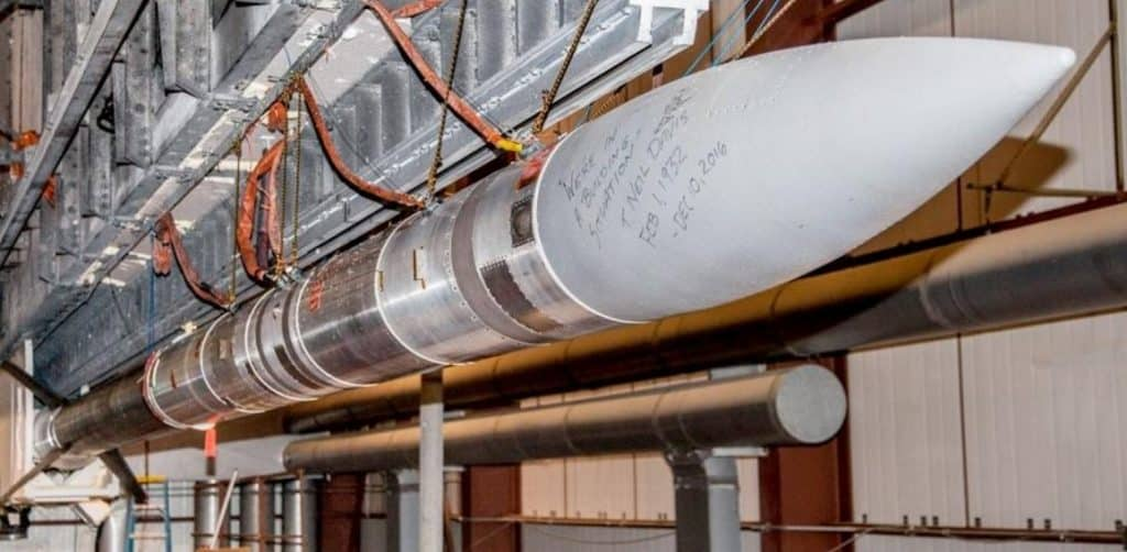 "A 45-foot NASA sounding rocket set for launch in February, 2017 at Poker Flat Research Range north of Fairbanks. Workers there wrote on the nose cone of the aurora-research rocket a frequent quote from range founder Neil Davis: ""'We're in a building situation.' T. Neil Davis, Feb. 1, 1932 - Dec. 10, 2016."" NASA photo."