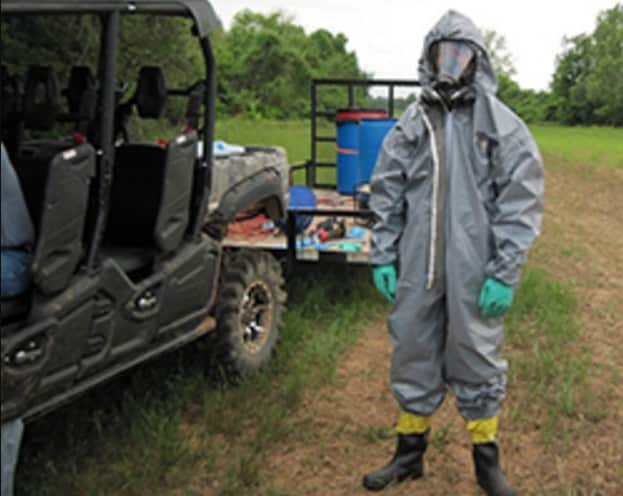 Investigating cases that involve the unlawful use of poisons is hazardous. The photo shows the special agent wearing a protective suit while investigating this case. Credit: USFWS