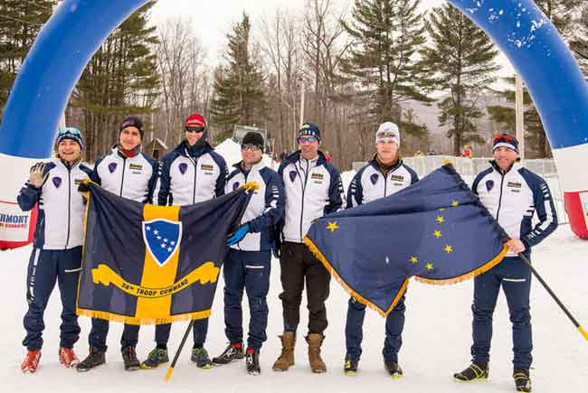 From the left, Spc. Tadhg Nakada, Pvt. Everett Darrow, 2nd Lt. Eric Gorman, 1st Sgt. Travis Kulp, Maj. David Cunningham, Pfc. Travis Cooper, and Staff. Sgt. Jack Androski proudly display Alaska flags during the 2017 Chief of the National Guard Bureau Biathlon Championships at Camp Ethan Allen Training Site, Jericho, Vt., held March 5-9, 2017