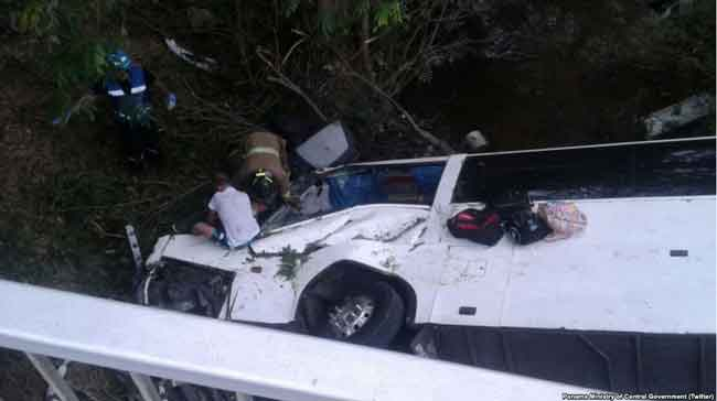 Rescuers work to free victims from inside the overturned bus in Anton, Cocle, Panama.