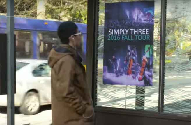 UW researchers used FM radio signals to broadcast music and data notifications from a Simply Three band poster at a Seattle bus stop to a smartphone. An antenna made of copper tape was embedded on the back of the poster.University of Washington