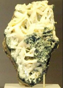 Naturally formed crystals of the mineral whitlockite, which is rare on Earth, are visible in this sample on display at Canada's Royal Ontario Museum. (Credit: Wikimedia Commons)
