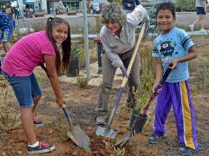 Planting native plants. (Photo: Lisa Cox--FWS)
