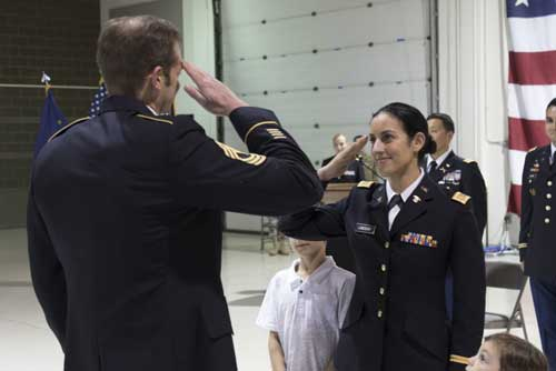 2nd Lt. Marisa Lindsay receives her first salute as an officer from Master Sgt. Michael Lindsay, Special Forces Advisor with the 1-196th Infantry Regiment, during a commissioning ceremony at the National Guard armory on JBER. Lindsay will serve as a platoon leader for E Company, 207th Aviation Regiment. (U.S. Army National Guard photo by Spc. Michael Risinger)