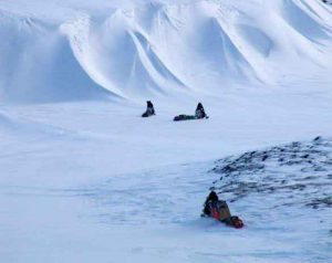 Matthew Sturm's partners on a 2007 snowmachine traverse head toward Daring Lake in Canada's Northwest Territories. Photo by Matthew Sturm