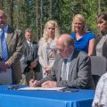 Governor Walker signing House Bill 23 in North Pole on Wednesday. Image-State of Alaska