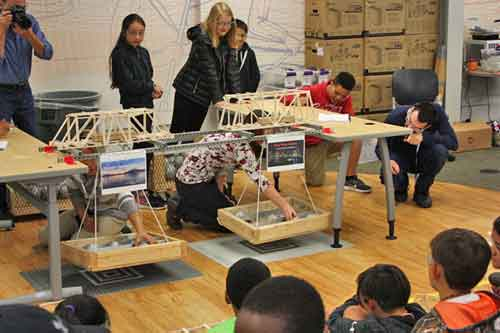 Middle School Academy Students load testing different bridge builds. Image-ANSEP
