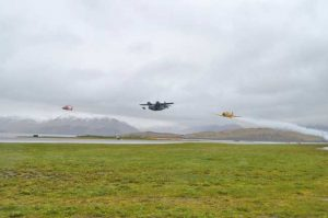 Coast Guard Cutter Midgett's aviation detachment conducts flyovers alongside historic WWII airplanes, a Grumman JRF-5 Goose and a Canadian Harvard MK IV training plane, in Dutch Harbor. U.S. Coast Guard photo