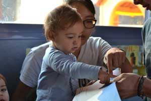 UW student Jinnie Yi works with a toddler at one of the participating infant education centers in Madrid.I-LABS