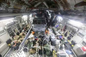 Alaska and California Air National Guardsmen are transported to Fort Hood, Texas, along with two HH-60 Pave Hawk helicopters that have been configured to fit inside of the massive C-17 Globemaster III transport aircraft Aug. 29, 2017. (U.S. Army National Guard photo by Staff Sgt. Balinda O'Neal Dresel)