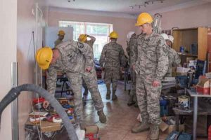 Alaska Air Guardsmen from the 176th Civil Engineer Squadron and support units repair a children's rehabilitation center in Riga, Latvia during their two-week annual training. Image-MVA