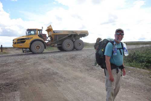 Eric Troyer hikes with Ned Rozell along the path of the Trans-Alaska Pipeline. Photo by Ned Rozell.