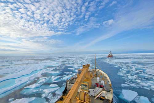 The crew of U.S. Coast Guard Cutter Maple follows the crew of Canadian Coast Guard Icebreaker Terry Fox through the icy waters of Franklin Strait, in Nunavut Canada. U.S. Coast Guard photo by Petty Officer 2nd Class Nate Littlejohn