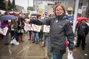 Nelli Williams, from Trout Unlimited's Alaska Program, speaks at an anti-Pebble Mine rally on Aug. 21, in Anchorage, Alaska. Photo by Brandon Hill.