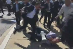 Turkish security official kicking man with bullhorn in Washington D.C. Image-VOA