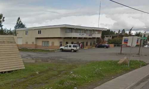 Police in Anchorage are investigating a homicide at Aurora Paint Company, and have a person of interest in custody. Image-Google Maps
