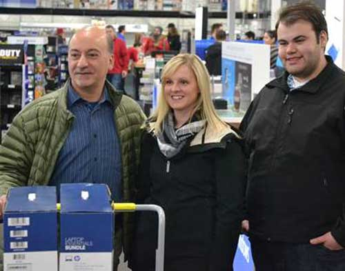 Gara, Metivier and UAA Graduate and laptop recipient Gary Lohse shopping for Laptops