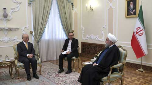 In this photo released by the office of the Iranian Presidency, President Hassan Rouhani, right, speaks with Director General of the International Atomic Energy Agency, IAEA, Yukiya Amano, left, during their meeting, in Tehran, Iran, Oct. 29, 2017.