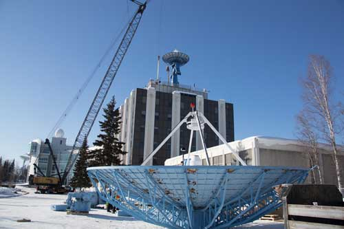 The new AS-2 antenna stands atop the Elvey building at the University of Alaska Fairbanks. In the foreground rests the old AS-2 antenna it replaced. Credits: Jeff Beiderbeck/PWP Photography