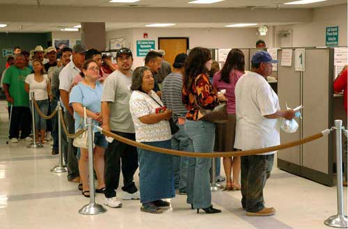 Unemployed in line at employment office. Image-FEMA