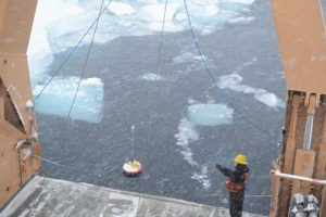A seasonal ice beacon floats in the Arctic Ocean after a research team deploys it from the ice breaker, the USCGC Healy. Photo by Ignatius Rigor of the Polar Science Center, Applied Physics Laboratory University of Washington.