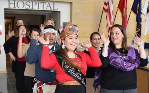 Cultural song and sway...Naval Hospital Bremerton (NHB) staff members join visiting members of the S'Klallam tribe in a traditional dance during NHB's American Indian and Alaska Native Heritage Recognition ceremony held on Nov. 17, 2017 (Official Navy photo by Douglas H Stutz, Naval Hospital Bremerton Public Affairs).