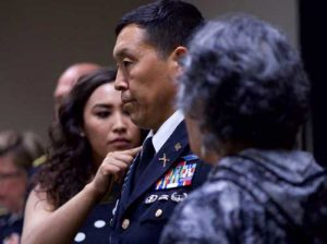 Alaska Army National Guard Col. Wayne Don, 38th Troop Command commander, looks on as his daughter, Phylicia (left), and mother, Annie, pin on full colonel rank insignia. (U.S. Army photo by Sgt. David Bedard)