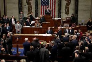 U.S. House Republicans applauding the passage of their tax overhaul. Image-VOA