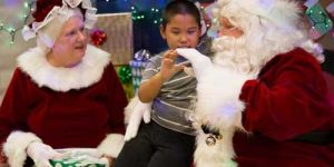 Santa and Mrs. Claus meet young St. Michael boy during this year's Op Santa to the village. Image-2nd Lt. Marisa Lindsay