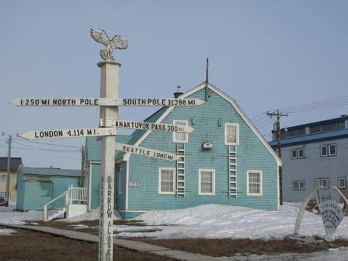 A signpost indicates geographic distances from Utqiagvik, formerly Barrow, where evidence of a warming climate has been dramatic this winter. Photo by Ned Rozell